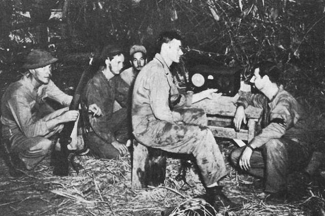 Soldiers on Bataan, Luzon Island, Philippines listen to a Voice of Freedom radio broadcast between battles with the Japanese in late 1941/early 1942. Americans finally surrendered after months of fighting without food, adequate ammunition or reinforcements.