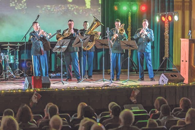 The 399th Army Band Missouri Brass Quintet performs during the Fort Leonard Wood Holiday Memories Concert held Friday at Baker Theater.