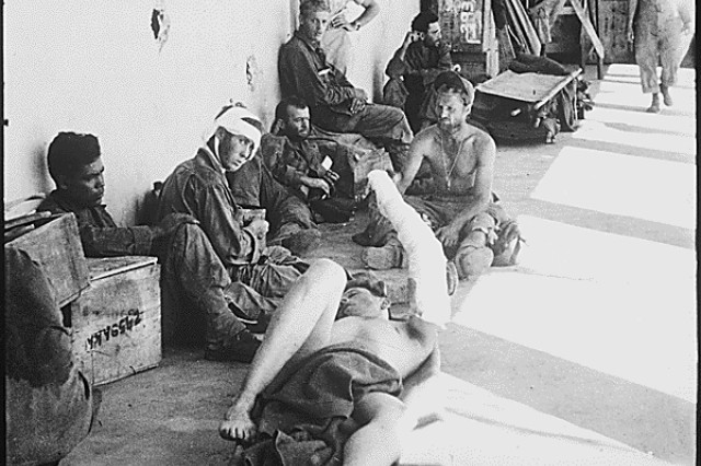 American prisoners of war, liberated from Cabanatuan prison camp on Luzon Island, Philippines, wait to be transferred to a hospital. Army Rangers, Alamo Scouts and Filipino guerrillas rescued more than 500 POWs from the camp, Jan. 30, 1945. They had endured years of torture and deprivation at the camp, while other POWs had been transferred to act as slave labor.