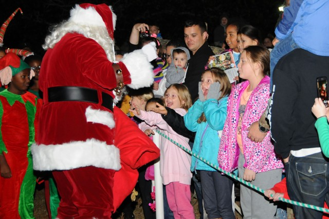 Children react as they meet Santa Claus after the tree lighting ceremony at the Howze Field Dec. 1.