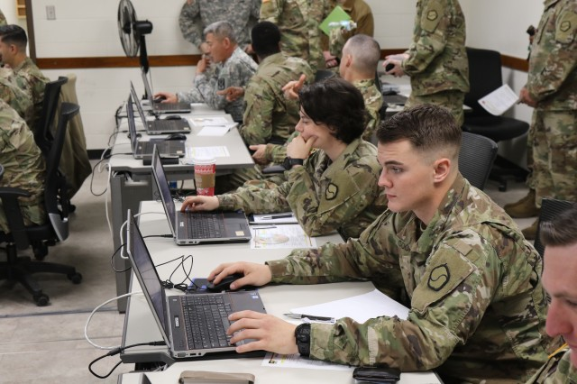 Junior Leaders from the Eighth Army open class materials on the computers and listen to instructions from the 19th ESC instructors at Camp Henry during the Pacific Victor Sustainment University - Pilo