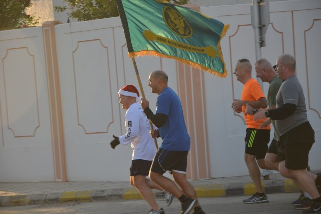 Staff members from various organizations at Eskan Village in Saudi Arabia gathered for a Fun Run in the early morning hours of Dec. 7. U.S. Army Security Assistance Command's Maj. Gen. Stephen Farmen and Brig. Gen. Frank Muth, program manager with the Office of the Program Manager-Saudi Arabian National Guard, spoke to the crowd before the run. These runs are a U.S. military tradition and usually take place around sunrise. They are distinguished by unit colors and guidons at the front of an organized formation and are intended to build esprit de corps as much as physical conditioning.