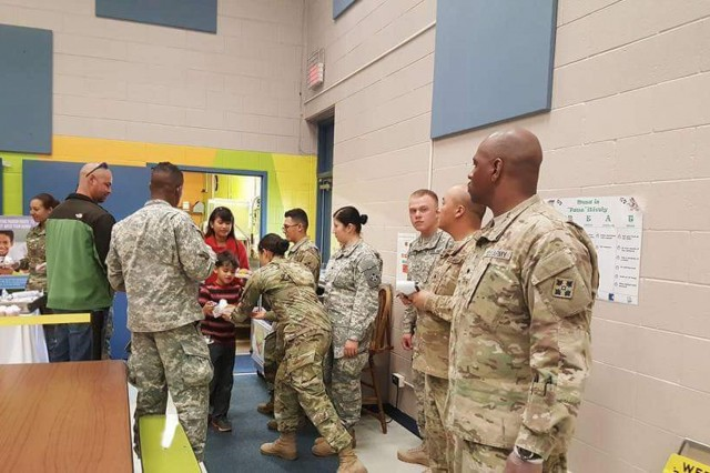 FORT CARSON, Colorado - A group of 25 Soldiers from 64th Brigade Support Battalion, 3rd Armored Brigade Combat Team, 4th Infantry Division, serve a Thanksgiving lunch to students at Fountain Mesa Elementary School in Colorado Springs, Colorado, Nov. 16, 2016. The Fort Carson Adopt-A-School program event provided an opportunity for Soldiers to reach out to the surrounding community and show support to their sponsor school. (Photo by Sgt. Brandy Rowlett, 3rd Armored Brigade Combat Team, 4th Infantry Division Public Affairs)