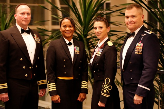 The Military Health System honored its top healthcare providers during an awards ceremony Dec. 1, at AMSUS Federal Health 2016 in Washington, DC. The recipients of the 2016 MHS Federal Military Nursing Excellence in Leadership Awards are (left to right): Nursing Junior (Navy) Lt. Cmdr. Shane Lawson, Pre-Commissioning Unit GERALD R. FORD (CVN 78), Norfolk, Virginia; Nursing Senior (MHS) Navy Capt. Andrea Petrovanie, Naval Medical Center San Diego; Nursing Junior (Army) Maj. Danielle Rodondi, Medical Department Center and School, Health Readiness Center of Excellence, Fort Sam Houston, Texas; and Nursing Junior (Air Force) Maj. Marion Foreman Jr., 412th Medical Group, Edwards AFB, California. (DoD Photograph by John Davis, U.S. Army/Released)