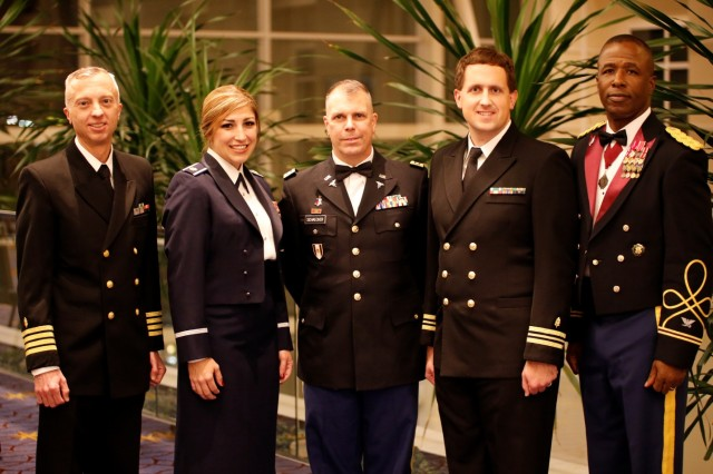 "The Military Health System honored its top military treatment facilities making ""advancements towards high reliability in healthcare"" during an awards ceremony Dec. 1, at AMSUS Federal Health 2016 in Washington, DC. Accepting awards on behalf of their commands for the 2016 Improved Access awards are (left to right): Capt. Jason Heaton, Naval Medical Center San Diego, Access to Specialty Care; Mark Smithwick and Capt Matthew Jansen, 97th Medical Group, Altus AFB, Oklahoma, Access to Primary Care (1st Place); Maj Brittanie Neaves, 14th Medical Group, Columbus AFB, Mississippi, Access to Primary Care (2nd Place); Dr. Robin Meadows, Fort Belvoir Community Hospital, Virginia, Pharmacy Access; Col. David Duplessis, Brooke Army Medical Center, San Antonio, Embedded Specialists; Sarah McComb, Naval Hospital Oak Harbor, Washington, Operational Access to Primary Care; and Maj Riliwan Ottun, U.S. Army Medical Command, San Antonio TX, Access to Primary Care (3rd Place). (DoD Photograph by John Davis, U.S. Army/Released)"