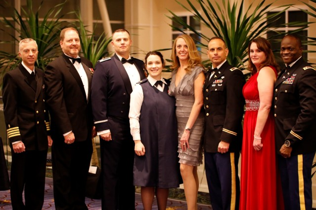 "The Military Health System honored its top military treatment facilities making ""advancements towards high reliability in healthcare"" during an awards ceremony Dec. 1, at AMSUS Federal Health 2016 in Washington, DC. Accepting awards on behalf of their commands for 2016 Healthcare Quality and Patient Safety awards are (left to right): Capt. Jason Heaton, Naval Medical Center San Diego, Honorable Mentions 1,5 and 7; Maj. Renee Matos, San Antonio Military Medical Center, Fort Sam Houston, Texas, Award 3 and Honorable Mentions 4 and 8; Lt. Col. Kurt Schaecher, Walter Reed National Military Medical Center, Bethesda, Maryland, Award 2; Lt. Cmdr. Brent Lacey, Naval Hospital Pensacola, Florida, Award 1; and Col. Lozay Foots III, Carl R. Darnall Army Medical Center, Fort Hood, Texas, Honorable Mention 3. Not pictured are command personnel for U.S. Naval Hospital Guam, Honorable Mention 2 and Wright-Patterson Medical Center, Dayton, Ohio, Honorable Mention 6. (DoD Photograph by John Davis, U.S. Army/Released)"