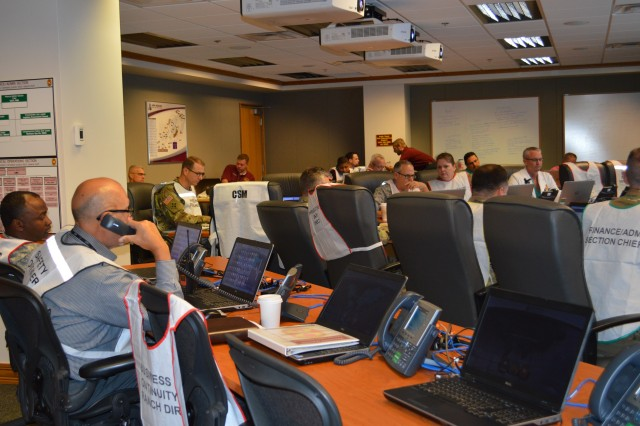 The designated incident commander and other key personnel from throughout Brooke Army Medical Center gather in the Emergency Operations Center Nov. 9, 2016 as part of the hospital's mass casualty exercise.
