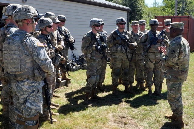 Joint Munitions Command Commanding General, BG Richard Dix, addresses Soldiers of the 101st Airborne Division 3rd Platoon during firing range exercises on Blue Grass Army Depot (BGAD).  The 101st was deployed to BGAD for the first time since 9/11 to support the annual Chemical Stockpile Emergency Preparedness Program (CSEPP) exercise.