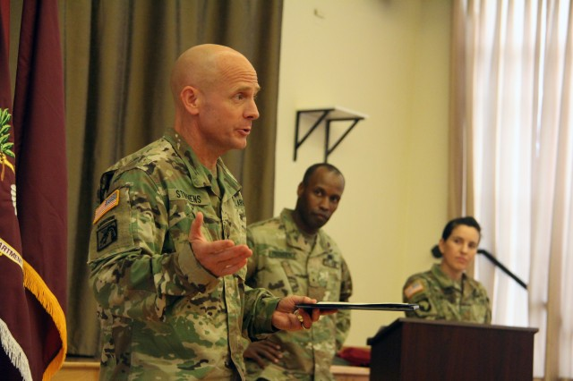 After being presented the National Defense University Certificate of Appreciation during a September awards ceremony for the lifesaving efforts provided to retired Gen. Mike Carns, Brig. Gen. Ronald T. Stephens, deputy commanding general, Regional Health Command-Pacific, briefly recounted the events that took place on Aug. 10, 2016. Brig. Gen. Bertram C. Providence, commanding general, RHC-P, middle, and Maj. Kathryn LoFranco, deputy executive officer, RHC-P, look on.
