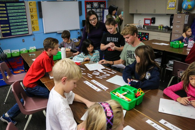 Student mentors from Tombstone High School show third-grade students at General Myer Elementary School different ways to learn math skills on Dec. 7. (Photo Credit: Fort Huachuca Public Affairs Lara Poirrier)