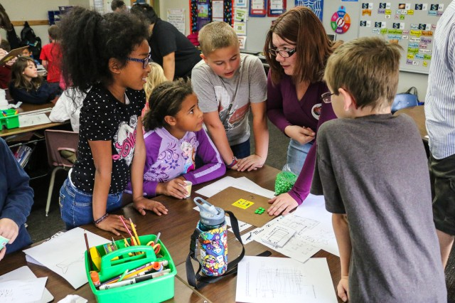 Student mentors from Tombstone High School show third-grade students at General Myer Elementary School how to use candy for learning math on Dec. 7. (Photo Credit: Fort Huachuca Public Affairs Lara Poirrier)