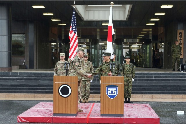 Lt. Gen. Kiyoshi Ogawa, commanding General of the Western Army, Japan Ground Self Defense Force, and Lt. Gen. Stephen Lanza, I Corps commanding General, shake hands following a successful Yama Sakura exercise in Camp Kengun, Japan Dec. 13, 2016. Exercise Yama Sakura 71 is an annual command post exercise co-sponsored by U.S. Army Pacific and the JGSDF. The purpose of the exercise is to enhance U.S. and Japan's combat readiness and interoperability while strengthening bilateral relationships and demonstrating U.S. resolve to support the security interests of allies and partners in the Indo-Asia- Pacific region. During the exercise, U.S. military members and JGSDF members exchange ideas, tactic, techniques, military experiences, and culture. Yama Sakura strengthens military operations, trust and friendship. (U.S. Army photo by Staff Sgt. Francis Horton)
