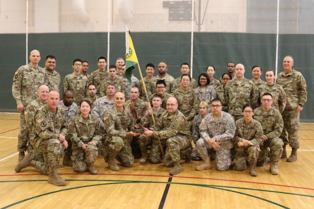 Soldiers of the United States Army Correctional Activity-Korea pose for a group photo with the Brig. Gen. Thomas F. Barr Award for being the best Military Police unit assigned to, attached to, or supp