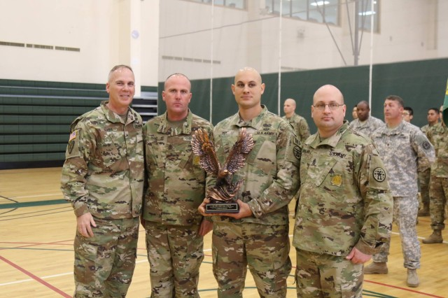 Brig. Gen. David P. Glaser, Commander, U.S. Army Corrections Command, poses for a group photo with United States Army Correctional Activity-Korea leadership Capt. Derick M. Hoy, Sgt. Maj. Justin E. Sh