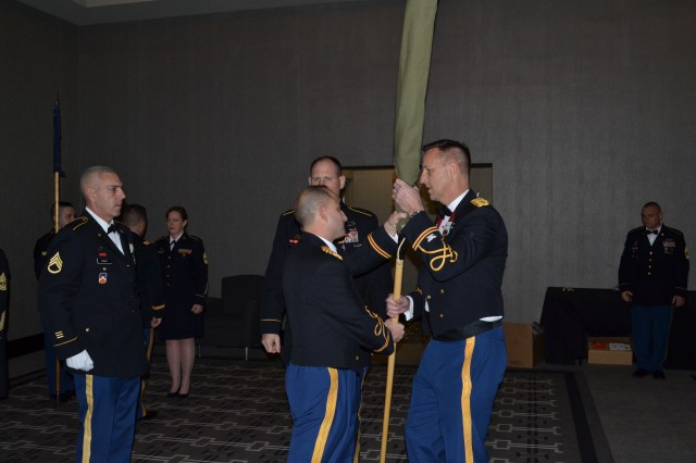 The 3rd Battalion of the 379th Regiment Commander, Lt. Col. Roderick Laughman (left) receives the encased battalion colors from Col. Bradly Boganowski, commander of the 800th Logistics Support Brigade, at the battalion's deactivation ceremony. The ceremony marks the closing of the unit as part of a larger restructuring of the 800th Logistics Support Brigade, headquartered in Mustang, Oklahoma. (Photo Credit: Sgt. 1st Class Emily Anderson)