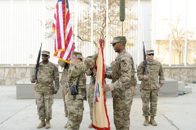 Col. Carol Tschida and Sgt. Maj. Darnyell Parker case the 419th Contracting Support Brigade organizational colors during an Expeditionary Contracting Command-Afghanistan transfer of authority ceremony Dec. 3 at Bagram Airfield, Afghanistan. Members of the 410th CSB deployed from Joint Base San Antonio-Fort Sam Houston, Texas, in November to relieve the 419th CSB, which returns to Fort Bragg, North Carolina. Tschida is the 419th CSB commander and Parker is the 901st Contracting Battalion sergeant major.