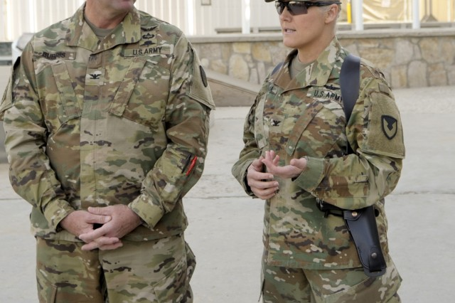 Col. Josh Burris and Col. Carol Tschida share a few moments before an Expeditionary Contracting Command-Afghanistan transfer of authority ceremony Dec. 3 at Bagram Airfield, Afghanistan. Authority was transferred between the 410th Contracting Support Brigade from Joint Base San Antonio-Fort Sam Houston, Texas, led by Burris and the 419th CSB, commanded by Tschida, which returns to Fort Bragg, North Carolina.