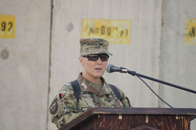 Col. Carol Tschida addresses leaders, supported customers and Soldiers attending an Expeditionary Contracting Command-Afghanistan transfer of authority ceremony Dec. 3 at Bagram Airfield, Afghanistan. Authority of ECC-Afghanistan transferred from the 419th Contracting Support Brigade, led by Tschida, to the 410th CSB from Joint Base San Antonio-Fort Sam Houston, Texas.