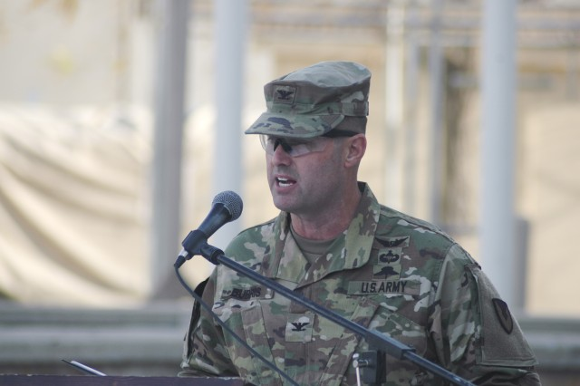Col. Josh Burris pledges his continued contracting support to leaders during an Expeditionary Contracting Command-Afghanistan transfer of authority ceremony Dec. 3 at Bagram Airfield, Afghanistan. Authority of ECC-Afghanistan transferred from the 419th Contracting Support Brigade from Fort Bragg, North Carolina, to the 410th CSB from Joint Base San Antonio-Fort Sam Houston, Texas. Burris is the commander of the 410th CSB.