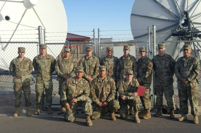 Test Soldiers for the Joint Tactical Ground Station limited user test are: (back row, left to right, with Test Detachment, 3rd Battalion, 6th Air Defense Artillery, 30th ADA Brigade from Fort Sill, Oklahoma) Spc. Chase Pulley, Sgt. 1st Class James Harris (1st Space Brigade, Fort Carson, Colorado), Spc. Richard Capitillo, Spc. Tyler Orcutt, Staff Sgt. Roger Euller, Sgt. Matthew Johnson, Spc. Jacob Lemmons, Sgt. James Lopez, and Chief Warrant Officer 3 Michael Gross (1st Space Brigade, Fort Carson, Colorado). Front row, left to right, are Staff Sgt. Daniel Romero, Spc. Andrew Franco, and Spc. Marshall Bullock.