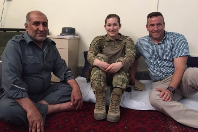 "1st Lt. Eva M. Gibbons as an advisor in Afghanistan with the training team's  Jon Washburn and an Afghan officer, following lunch provided by the Afghan police.  ""Hospitality plays a large role in Afghan culture and is instrumental in establishing good rapport,"" she said."