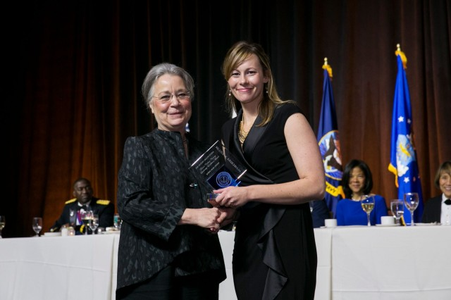 Registered nurse Lydia Kreighbaum is presented the 2016 Military Health Service Federal Civilian Nursing Excellence in Leadership Award (Nursing Junior Army) by Acting Assistant Secretary of Defense for Health Affairs Dr. Karen Guice. (Photo courtesy of AMSUS)