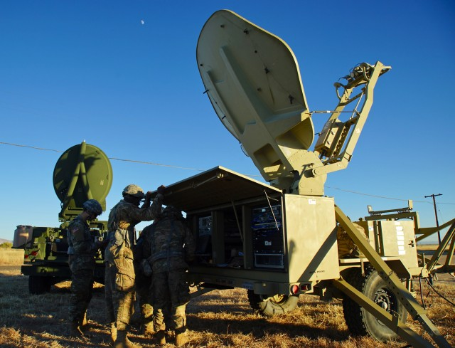 Soldiers work on a communications sytem