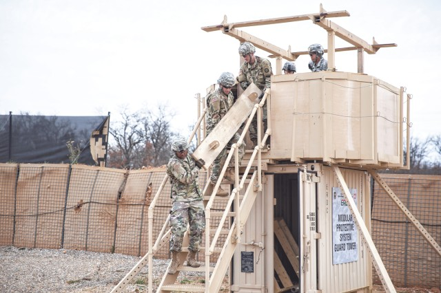 Soldiers from 50th Multi-Role Bridge Company, 5th Engineer Battalion, disassemble the Modular Protective System Multipurpose Guard Tower for transport.