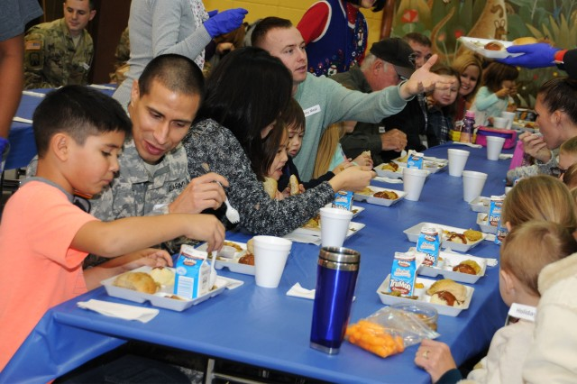 Families enjoy a holiday meal at Fort Rucker Primary School Dec. 7.