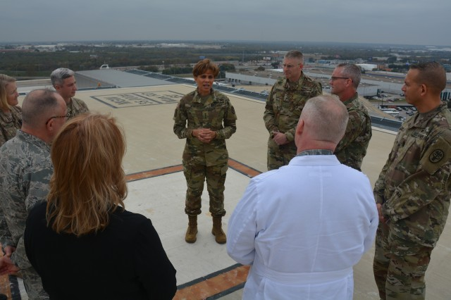 Lt. Gen. Nadja West, Army Surgeon General, talks with Army and Air Force doctors about Brooke Army Medical Center's trauma mission Dec. 14, 2016 as they tour the only rooftop helipad in the Department of Defense.  West stressed the importance of maintaining the readiness of military medical personnel.
