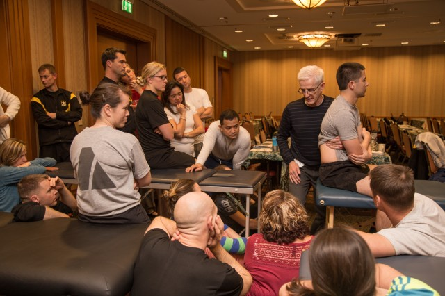 Physical Therapy providers watch a demonstration during one of their breakout sessions during the Regional Health Command Europe Fall Continuing Medical Education Training event.