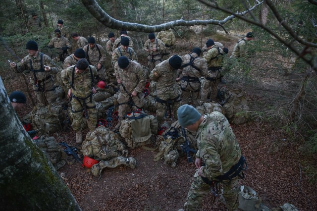 U.S. Army Soldiers with Scout Platoon, 2nd Battalion, 503rd Infantry Regiment, 173rd Airborne Brigade prepare their gear before rappelling down a ravine during German Mountain Warfare Training in Seinsbach Gorge, Mittenwald, Germany,  Dec. 8th, 2016.  The Mountain Warfare training was conducted from 5 to 16 Dec., to build proficiency in mountain terrain with reconnaissance operations and extreme cold weather survival techniques. This training was alongside other NATO allies including German, Polish, Lithuanian, Latvian and Estonian Armies.