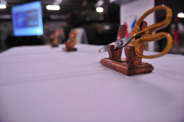 Scissors lie in a stand on the table prior to the ribbon-cutting cutting ceremony for the Army Prepositioned Stocks site at Eygelshoven Army Depot-BENELUX, Dec. 15.