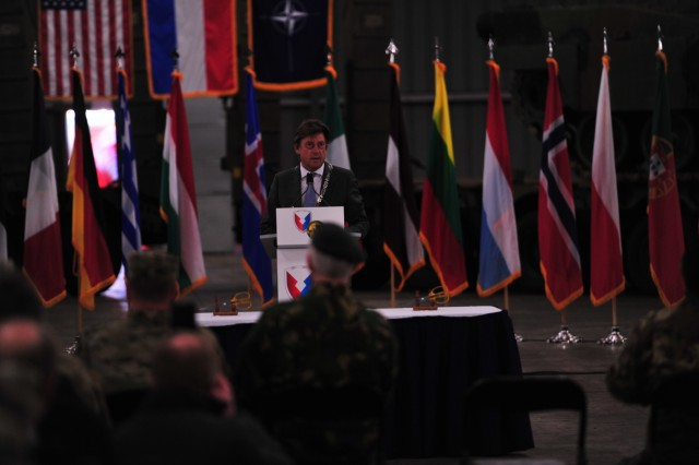 Edelachtbare Heer J. Som, mayor of Eygelshoven, Netherlands, welcomed the new Army Prepositioned Stocks site to his city, referencing the history of the area and how it has changed over the years.