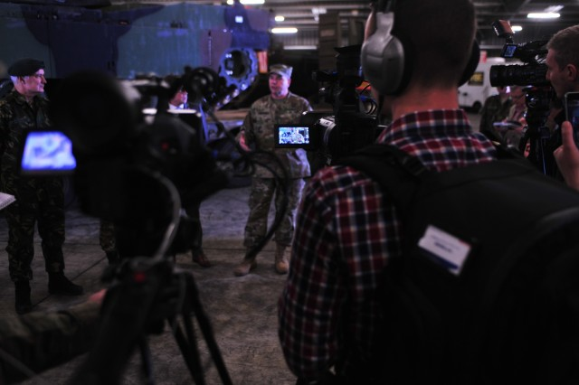 Lt. Gen. Ben Hodges, commanding general, U.S. Army Europe speaks to reporters after the ribbon-cutting ceremony for the Army Prepositioned stock site at Eygelshoven Army Depot-BENELUX, Dec. 15.