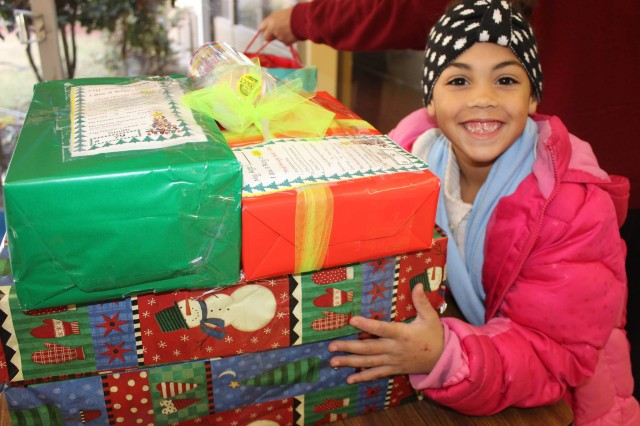 A first-grader at Morris Elementary is thrilled with the gifts ACC provided.