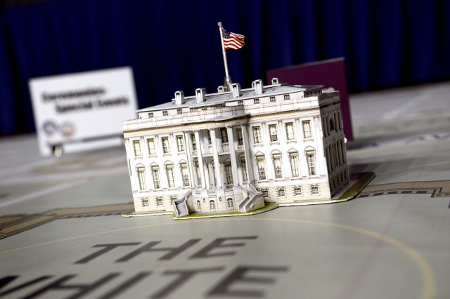 A model of the White House sits atop a 60' by 40' foot map, used during a ceremonial rehearsal of concept drill at the D.C. National Guard Armory in Washington, Dec. 14, 2016. This final planning symposium showcased the culmination of months of preparation between military and civilian entities for the 58th Presidential Inauguration.