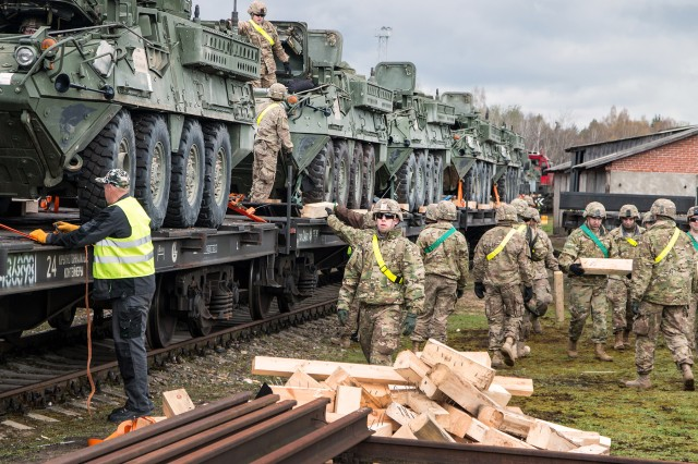Soldiers with Ghost Troop, 2nd Squadron, 2nd Cavalry Regiment, unload Strykers during a rail operation at Gaiziunai, Lithuania, on April 21, 2016. The equipment made the troop fully mission capable as it began its rotation in support of Operation Atlantic Resolve.