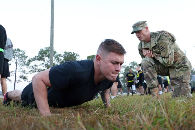A 3rd Infantry Division Soldier does pushups for an Army physical fitness test on Nov. 15, 2016, during Marne Week's Best Squad Competition at Fort Stewart, Georgia. The three-day event also features two ruck marches, a combat-related physical training event, and warrior task testing.