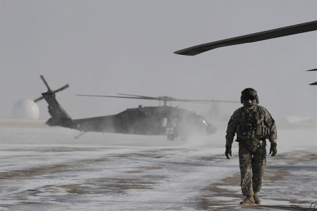 A Colorado Army National Guard crew chief conducts preflight checks on a UH-60 Black Hawk helicopter in preparation for a blizzard response exercise with local authorities at Buckley Air Force Base, Aurora, Colo., Jan. 9, 2016.