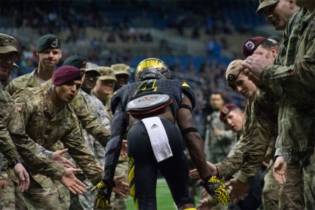 Mecole Hardman Jr. gets a little pregame motivation from Soldier-mentors at the Army All-American Bowl in San Antonio, Texas, Jan. 9, 2016.