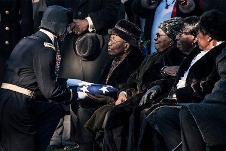 Capt. Craig Morin presents an American flag to 2nd Lt. Samuel G. Leftenant's eldest sister, Nancy Leftenant-Colon, during a full military honors memorial service held at Arlington National Cemetery in Arlington, Va., Jan. 14, 2016. Leftenant was a fighter pilot  and one of the famed African-American Tuskegee Airmen. Leftenant  was involved in a midair collision while escorting bombers to Sankt Viet, Austria, causing him to bailout of his damaged aircraft. He was reported MIA on April 12, 1945, and declared dead in 1946, since he was never found. Leftenant-Colon, from East Norwich, N.Y., was a nurse with the Army Reserves. She was stationed with the Tuskegee Airmen in Columbus, Ohio, after her brother died, and worked there until 1949.