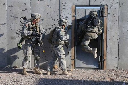 Soldiers breach a doorway, Jan. 26, 2016, to clear a building at Malakand Village, a mock urban town, during their company live-fire exercise at McGregor Range, N.M. They are with 3rd Battalion, 7th Infantry Regiment, 2nd Infantry Brigade Combat Team, 3rd Infantry Division.