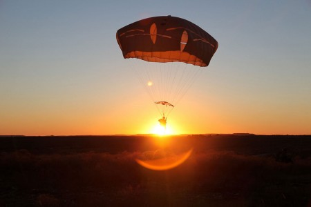 An Army paratrooper conducts airborne operations on Fort Hood, Texas, Feb. 9, 2016. The paratrooper is assigned to the 1st Brigade Combat Team, 82nd Airborne Division.
