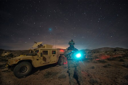 A civil affairs Soldier attached to 3rd Cavalry Regiment, conducts security during a convoy halt at the National Training Center, Fort Irwin, Calif., Feb. 12, 2016. The National Training Center conducts tough, realistic, training to prepare brigade combat teams and other units for combat.