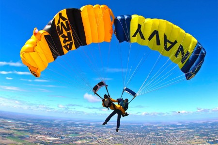 "Members of the U.S. Army Parachute Team ""Golden Knights"" and the U.S. Navy Parachute Team ""The Leap Frogs"" train together, Feb. 22, 2016, on canopy relative work over Homestead Air Reserve Base, Fla."
