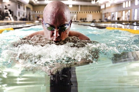 Sgt. David Jones practices his swimming technique, March 1, 2016, at the Aquatics Training Center on Fort Bliss, Texas.