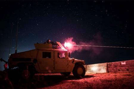 A Reserve military police Soldier shoots a M240B machine gun during night fire qualification at Fort Hunter Liggett, Calif., May 3, 2016.
