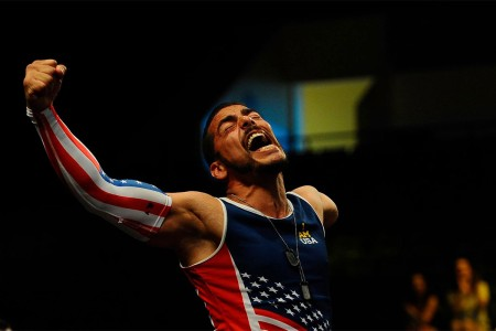 Staff Sgt. Michael Kacer, and Army veteran, celebrates during introductions, during the rowing finals at the Invictus Games 2016 in Orlando, Fla. May 9, 2016. The Invictus Games are composed of 14 nations, over 500 military competitors, competing in 10 sporting events May 8-12, 2016.