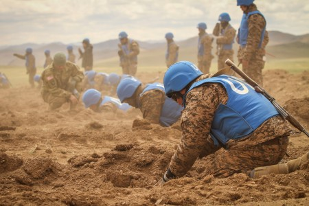 A Mongolian armed  forces soldier searches for explosives in a simulated minefield during self-extraction training at Khaan Quest 2016, Five Hills Training Area, Mongolia, May 25, 2016. Khaan Quest is an annual, multinational peacekeeping operations exercise hosted by the Mongolian Armed Forces, co-sponsored by U.S. Pacific Command and supported by U.S. Army Pacific and U.S. Marine Corps Forces, Pacific. Khaan Quest, in its 14th iteration, is the capstone exercise for this year's Global Peace Operations Initiative program. The exercise focuses on training activities to enhance international interoperability, develop peacekeeping capabilities, build to mil-to-mil relationships, and enhance military readiness.